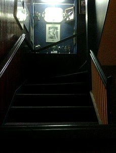 Britannia Yacht Club stairwell with Frank Amyot photo and trophies.JPG