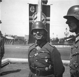 Rommel at a Paris victory parade (June 1940). Rommel had access to Reich Minister of Propaganda Joseph Goebbels via a senior propaganda official Karl Hanke, who served under Rommel during the 1940 campaign. Bundesarchiv Bild 146-1970-076-43, Paris, Erwin Rommel bei Siegesparade.jpg
