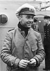 A smiling Prien is seen on deck, wearing his navy uniform.