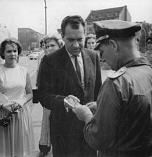 Nixon shows his papers to an East German officer to cross between the sectors of the divided city of Berlin, 1963