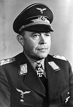 alt = Head-and-shoulders portrait of a uniformed Nazi German air force general in his 50s wearing an Iron Cross