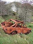 Burnt-out car on the edge of Headon clay pit - geograph.org.uk - 313094.jpg