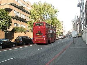 Mansell Street - Bus heading northwards up Mansell Street