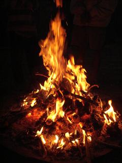 Campfire fire lit at a campsite