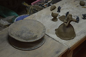 """Handcrafts and folk art in Oaxaca - A """"proto-turntable"""" and figure in progress from the Carlomagno Pedro Martínez workshop in San Bartolo Coyotepec"""