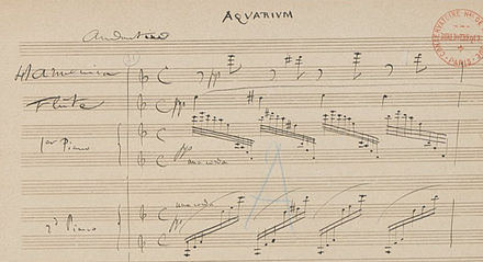 "Part of the original manuscript score of ""Aquarium"". The top staff was written for the (glass) ""Harmonica"". Play (help*info) Carnaval aquarium.jpg"