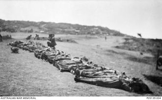 Raymond Leane - The bodies of the 36 members of the 11th Battalion killed during the capture of Leane's Trench