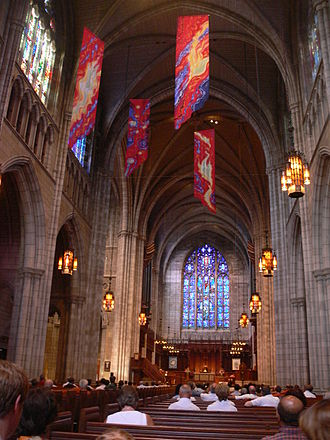 "Princeton University Chapel - The interior, looking east from about halfway through the nave. The choir and the east window, titled ""The Love of Christ"", are in the background."