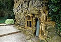 Chapel of Our Lady of the Crag with knight carving and ornate window. Knaresborough, England.jpg