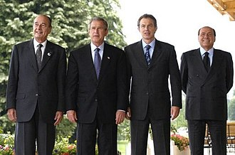 Iraq War - From the left: French President Jacques Chirac, U.S. President George W. Bush, UK Prime Minister Tony Blair and Italian Prime Minister Silvio Berlusconi. Chirac was against the invasion, the other three leaders were in favor.