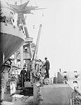 Cleaning 4.7-inch AA gun on HMS Rodney 1940 IWM A 89.jpg