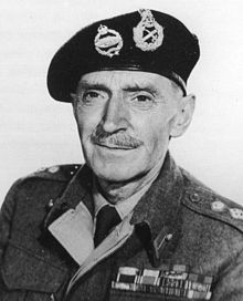 Black-and-white photograph of a middle-aged man dressed in British Army uniform