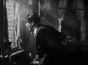 Pre-Code crime films - Paul Muni (as Tony Camonte) taunting and laughing at police officers he has just shot at in the trailer for Scarface (1932). The Hays office wanted this ending of the gangster film replaced with one where Muni's character is tried and executed.