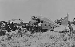 Monoplane lying in pieces in scrub