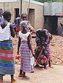 Crouching female and standing women Senegal.jpg