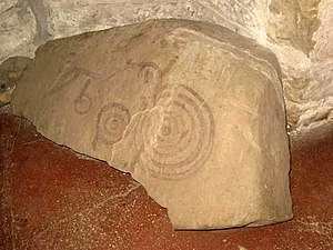 English: Cup and ring stone in St John Lee church