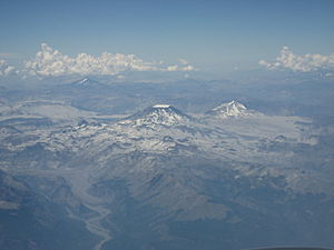 Cerro Azul (Chile volcano) - The mountain with the appearance of a truncated cone, at the centre of the image, is Descabezado Grande volcano, and close to it is the pyramidal Cerro Azul.