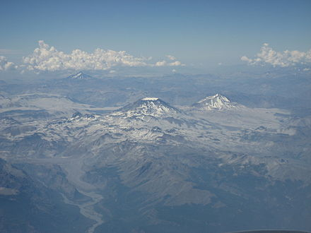The mountain with the appearance of a truncated cone, at the centre of the image, is Descabezado Grande volcano, and close to it is the pyramidal Cerro Azul. Descabezado Grande y Cerro Azul.jpg