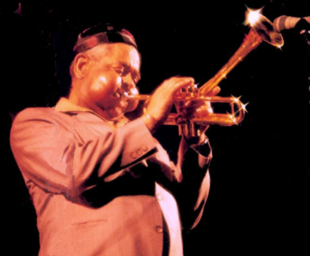 Gillespie performs with his bent trumpet in 1988. DizzyGillespie.png