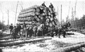 Drafthorses tow a huge sled of timber, from Curwood's 1909 The Great Lakes -aj.png