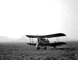 Military biplane on landing ground