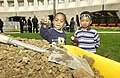 Earth Day Tree Planting Activities - Earth Day tree planting activities outside HUD Headquarters, featuring children from child care center, Assistant Secretary for Administration K - DPLA - 524a6c4105db98373e3252be2cee865d.JPG