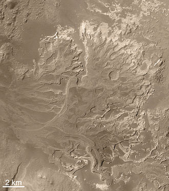 Valley network - The Eberswalde delta, seen by MGS. Note the meanders with cutoffs, now seen in inverted relief.