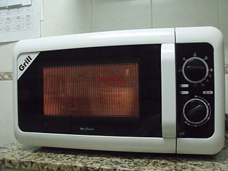 Microwave - Small microwave oven on a kitchen counter