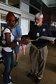 FEMA - 38103 - A FEMA employee passes out fliers to evacuees returning to Louisiana.jpg