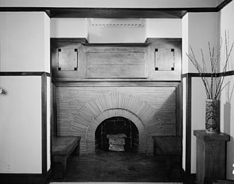 Frank Lloyd Wright Home and Studio - Fireplace, living room. Note that above the fireplace there is an optical illusion that there is no chimneystack, Wright used a mirror for this purpose