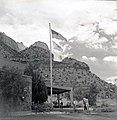 File-Mission 66 Visitor Center and Museum and bicentennial flags. -One of two images on single film strip for ZION 9061- ; ZION (b624d42870244dc18f2e03cf0406aa7e).jpg