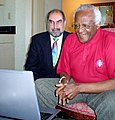 Firdaus Kharas and Desmond Tutu watching The Three Amigos.jpg
