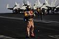 Flickr - Official U.S. Navy Imagery - A Sailor wears a clown suit while launching aircraft..jpg