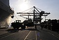 Flickr - Official U.S. Navy Imagery - Marines attached to Combat Logistics Regiment 3 use a tractor to move gear..jpg