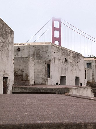 Mission blue butterfly habitat conservation - Abandoned buildings at Fort Baker are dwarfed by the Golden Gate Bridge.