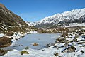 Frozen tarn in Hooker Valley with snow on the ground.jpg