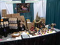 Gen Con Indy 2007 - booth with costumed people inside.JPG