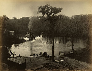 Silver Springs, Florida - Steamboat and railroad at Silver Springs in 1886.