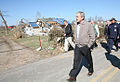 George W. Bush walks past rubble along a highway in Lafayette, Tennessee.jpg