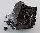 Glassy carbon and a 1cm3 graphite cube HP68-79.jpg