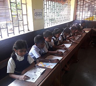 Education in India - School children reading books in government primary school library, in Goa