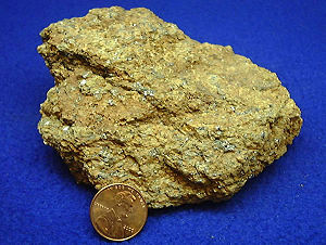 Carbon - Graphite ore. Penny is included for scale.