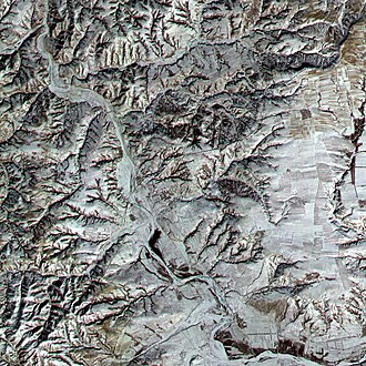 A satellite image of a section of the Great Wall in northern Shanxi, running diagonally from lower left to upper right and not to be confused with the more prominent river running from upper left to lower right. The region pictured is 12 km x 12 km (7 mi x 7 mi). Great Wall of China, Satellite image.jpeg