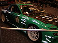 Green 3rd gen Mazda RX-7 racer side.JPG