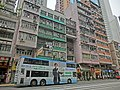 HK Sai Ying Pun 德輔道西 Des Voeux Road West bus body ads 中國太平保險集團 China Taiping Insurance Group 成龍 Jackie Chan April 2013.JPG