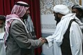 Haji Gull Maula, right, shakes hands with and thanks Ali Alqatar after Alqatar's speech at the King Abdula mosque in Amman, Jordan, April 21, 2011, during the Voices of Religious Tolerance (VORT) conference on 110421-M-GW940-052.jpg