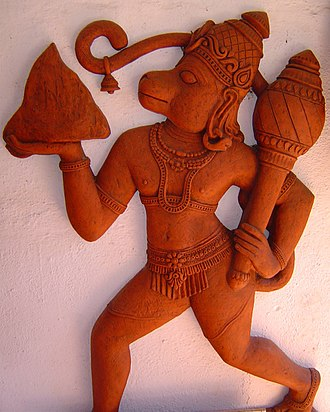 Vanara - Sculpture of Hanuman, a king among the Vanara, carrying the Dronagiri mountain.