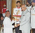 He President, Shri Ram Nath Kovind presenting the Padma Vibhushan Award to Shri Illaiyaraja.JPG