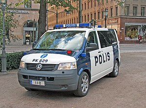 Law enforcement in Finland - A Finnish police van in the old livery featuring vanity plates promoting the common European emergency telephone number 1-1-2