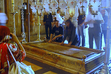 The Stone of the Anointing, believed to be the place where Jesus' body was prepared for burial. It is the 13th Station of the Cross. Holy sepulchre stone of the anoiting.jpg